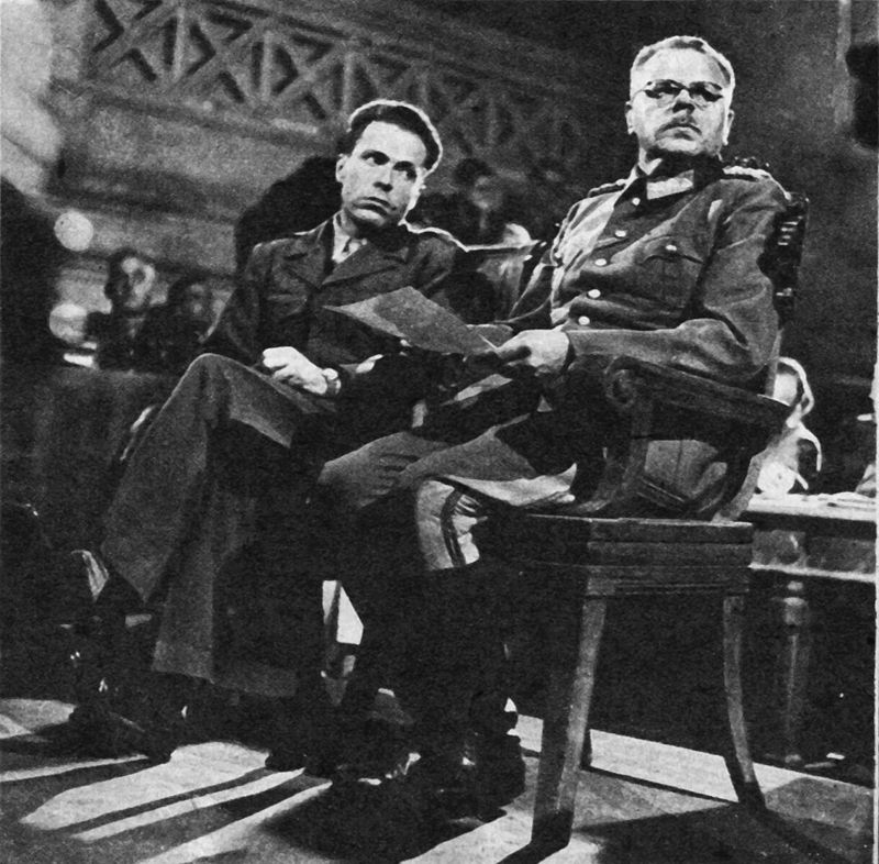 Anton Dostler on trial in 1945 — at the Palace of Caserta in Italy. His interpreter is Albert O. Hirschmann.